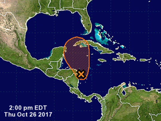A tropical disturbance in the Caribbean Sea could bring