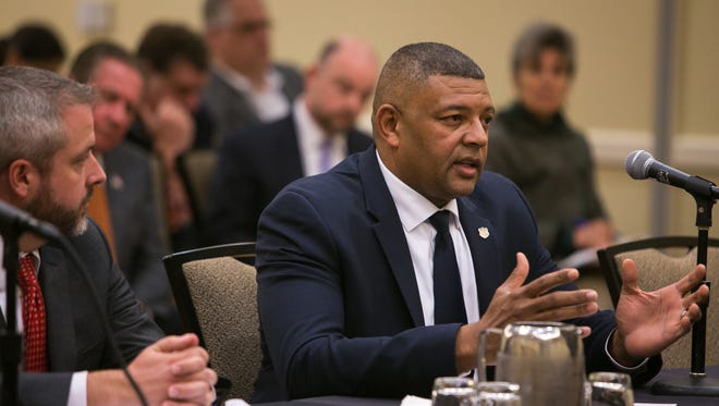 Delaware Department of Correction Commissioner Perry Phelps answers questions from the Delaware State Senate Labor Committee during a public hearing at the Chase Center on the Riverfront.