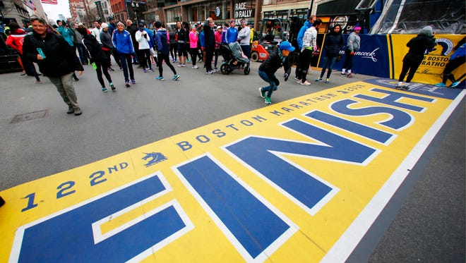 People gather at the Boston Marathon finish line in Boston on April 15 ahead of Monday's race.