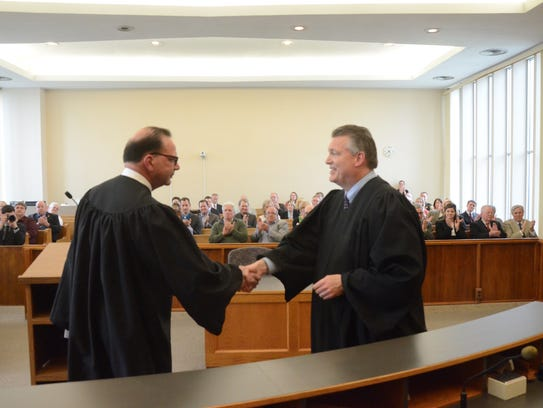 Paul Beardslee is congratulated by Probate Judge Mike