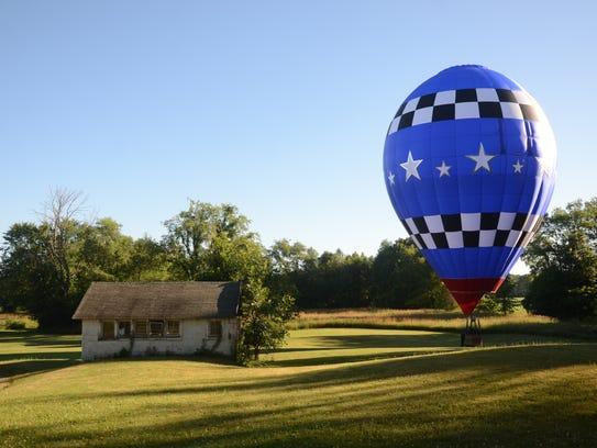 Joe Heartsill lands his balloon on property on Division