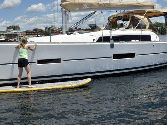 AnnMarie Harmon of Waitsfield cleans her boat Sunday