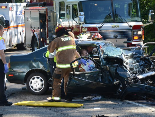 Pennfield firefighters had to use power equipment to get into the car that Mike and Samantha Campbell were in after a crash on Aug. 1, 2016.