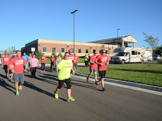 Runners and walkers leave the Marshall Regional Law