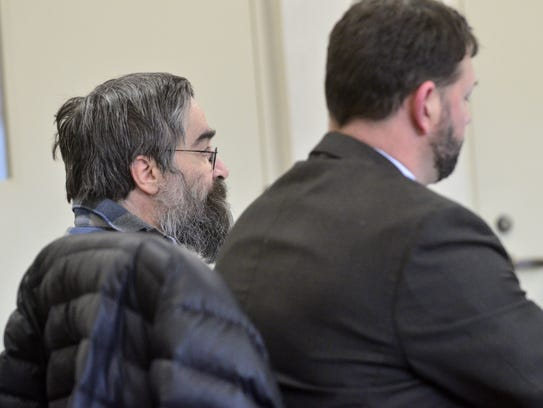 Murder suspect Jose Pazos, left, sits with his lawyer