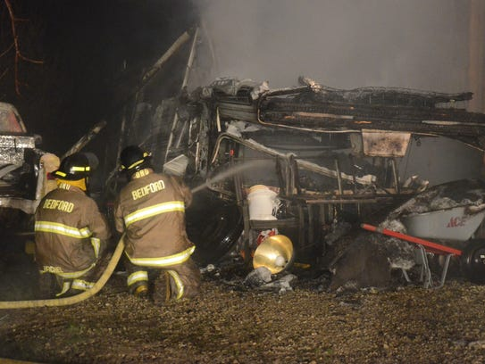 Bedford Township firefighters extinguish the remaining