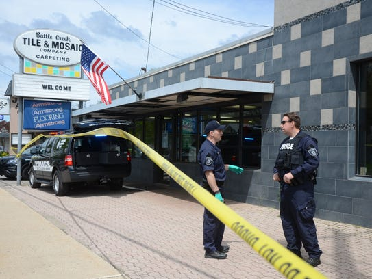 Officers outside the business where Frankie Zanetti