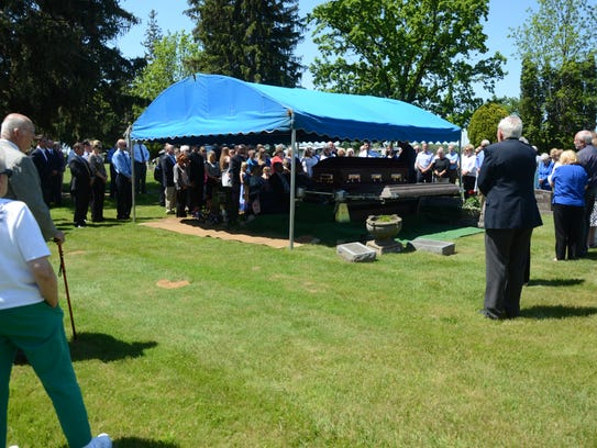 Mourners at the funeral Friday of Larry Jenkins.