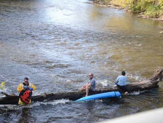 Ron and Lois Fields were stranded on a log in the Kalamazoo