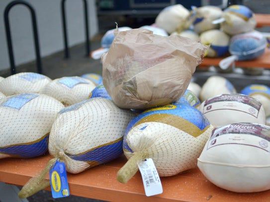 Turkeys donated during a turkey drive at Bluebird BBQ