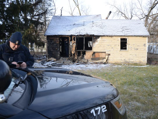 Lt. Tony Geigle outside an abandoned home which was