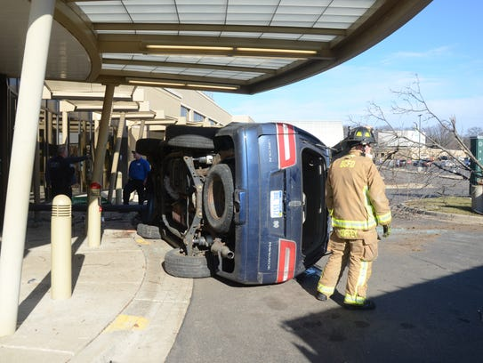 The vehicle slid within a few feet of an entrance of