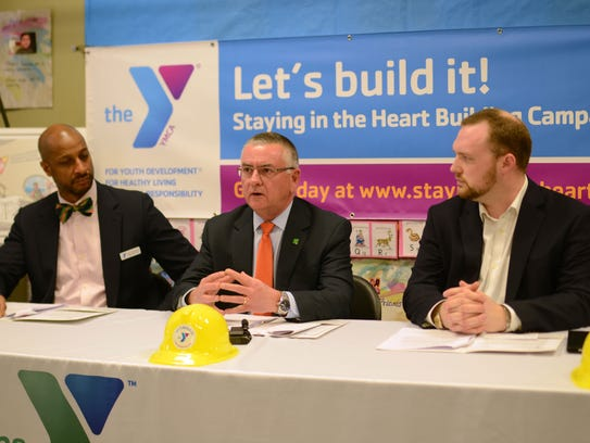 Phil Daniels, center, a YMCA board member and co-chairman