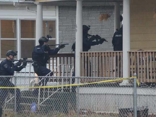 Battle Creek officers enter a home on Merritt Street