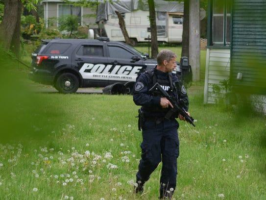 Lt. Matthew Robinson patrols near a house on Somerset