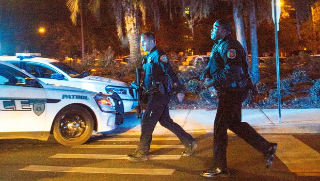 Police officers carrying assault rifles Nov. 20, 2014, near Strozier library at Florida State University in Tallahassee, Fla.