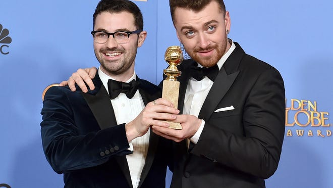 """Sam Smith, right, and songwriting partner Jimmy Napes celebrate their Golden Globe win in January. They won for best original song in a motion picture for """"Writing's on the Wall"""" from """"Spectre"""" and are nominated in the same category at Sunday's Oscars."""