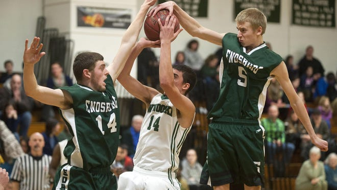 Enosburg's Calvin Carter, right and Caleb Laroche, left, team up to block a shot by Winooski's Sean Callahan during the second half of Saturday's boys basketball game.
