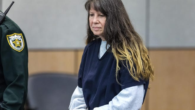 Sheila Keen-Warren, accused of dressing as a clown and fatally shooting her lover's wife, enters court ahead of her first-degree murder trial scheduled to start May 29. Keen-Warren was arrested in 2017 and extradited from Virginia, where she lived with husband Michael Warren. [LANNIS WATERS/palmbeachpost.com]