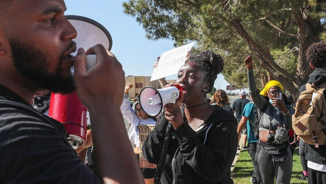 Robert Hoskins of Hesperia, left, and Princess Berry, center, of Victorville, participate in a protest on Tuesday, June 16, 2020, in search of answers about Malcolm Harsch's death. Harsch was found hanging from a tree in Victorville on May 31.