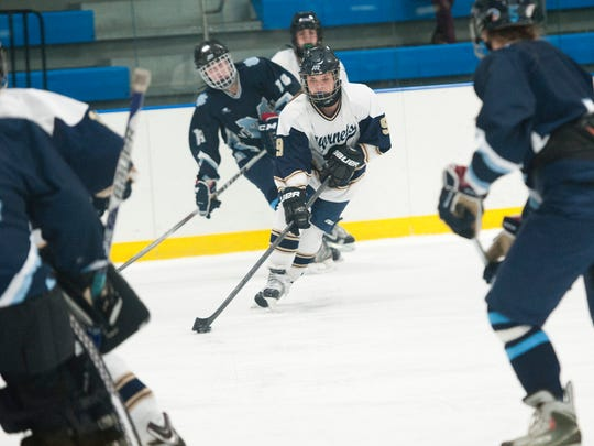 Essex's Kathleen Young moves the puck during a high school girls hockey game last season.