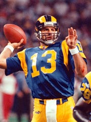 St. Louis Rams' quarterback Kurt Warner (13) tosses his third touchdown pass during the first quarter Sunday, Oct. 10, 1999, during the Rams' 42-20 victory against the San Francisco 49ers in St. Louis, Mo. Warner threw for 323 yards and five touchdowns during the game. (AP Photo/Tom Gannam)