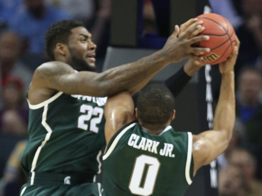 Michigan State's Branden Dawson and Marvin Clark Jr. rebound against the Virginia Cavaliers on March 22, 2015 in Charlotte, N.C.