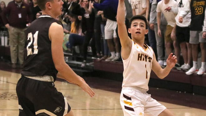 Hays High's Jason Krannawitter hits a buzzer beater during a game last season at HHS. USD 489 announced guidelines for winter sports on Monday.