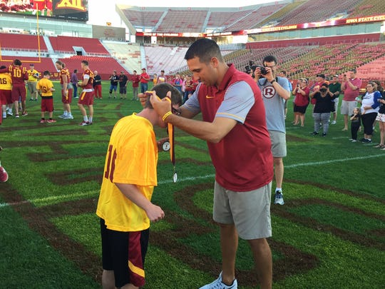 Everyone won a gold medal at Saturday night's Victory Day at Jack Trice Stadium. Matt Campbell awarded all 60 of them.