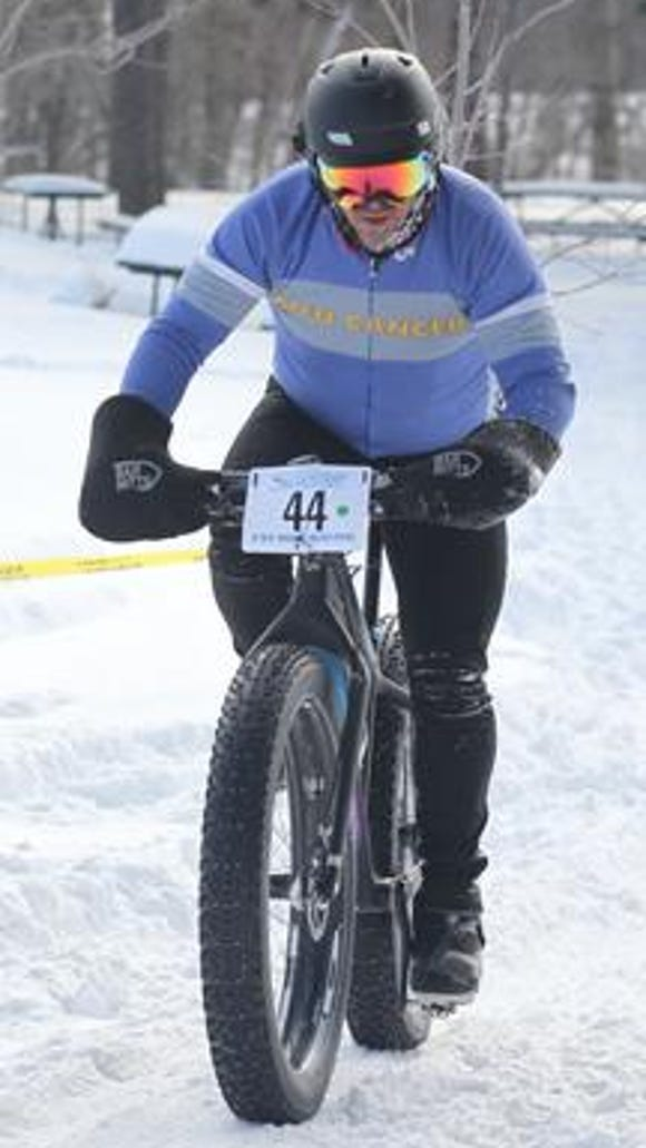 Mike Bobelak of St. Louis, Missouri, finishes his 14 mile ride at the Badger State Winter Games Fat Tire Bike Racing event at Sunny Vale Park in Wausau Jan. 18, 2014.