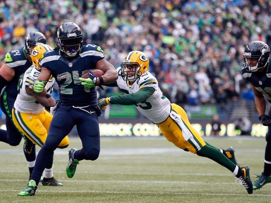 Seattle Seahawks running back Marshawn Lynch runs for a touchdown against the Green Bay Packers during the fourth quarter of Sunday's NFC championship game at CenturyLink Field in Seattle.