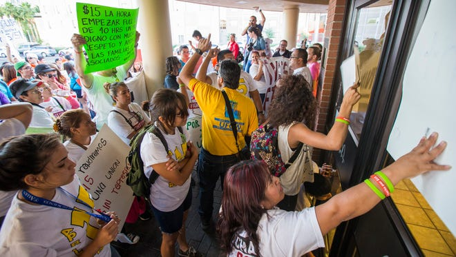 Protesters rally Wednesday, April 15, 2015, outside a McDonalds near ASU to raise the minimum wage to $15 an hour. Employees locked the doors to the restaurant for about 20 minutes until the demonstrators left.