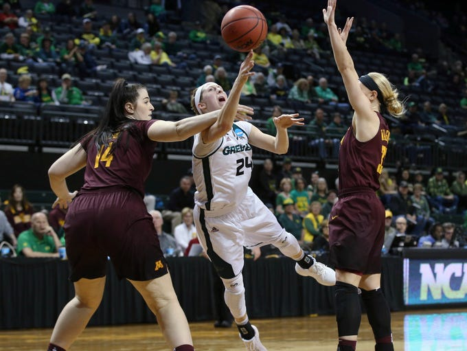 Green Bay's Allie LeClaire, center, shoots between