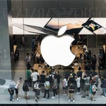 Customers browse inside Apple's new Canton Road store in the Tsim Sha Tsui district of Hong Kong, China, on Thursday, July 30, 2015. Apple opened its fourth store in Hong Kong.