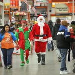 Home Depot manager Erica Jarmon (from left) assisted Mark Davis and Tony Gregg on Nov. 28 during Black Friday at the store at 3902 N. High School Road.