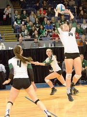 Novi's Erin O'Leary (right) makes the back-set to Ally Cummings (middle) with Emmy Robinson (4) awaiting the attempt.