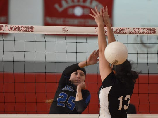 Passaic Tech's Savanna Skely (25) spikes the ball during the Passaic County tournament semifinals, at Lakeland, on Wednesday.