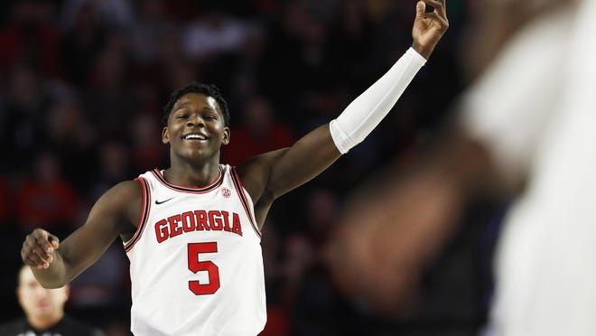 Georgia's Anthony Edwardscelebrates after a 3-pointer against Arkansas in a game last season at UGA's Stegeman Coliseum.