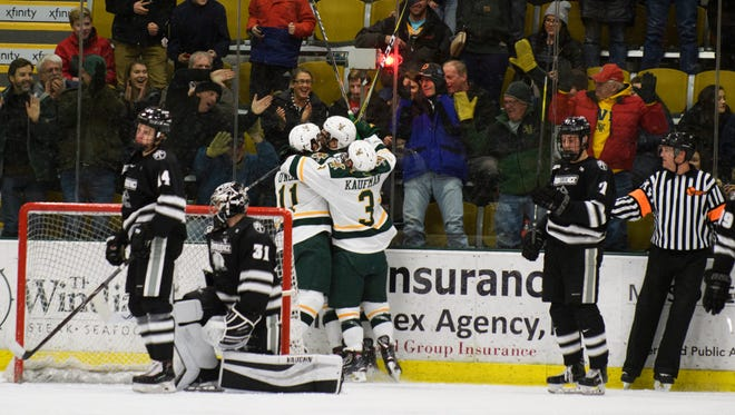 Vermont celebrates a goal during the men's hockey game between the Providence Friars and the Vermont Catamounts at Gutterson Fieldhouse on Friday night February 2, 2018 in Burlington.