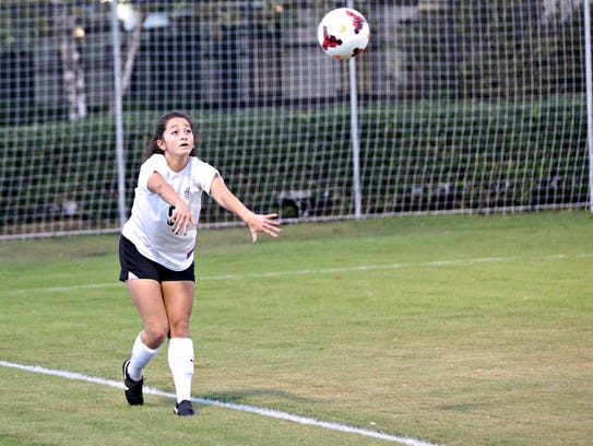Central Magnet junior defender Lauren Sanchez tosses