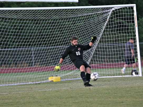 Oakland keeper Jakob Hurst gets into a kick during