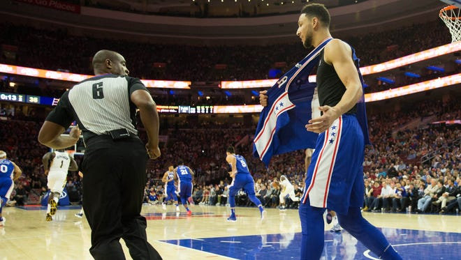 Nov 3, 2017; Philadelphia, PA, USA; Philadelphia 76ers guard Ben Simmons (25) reacts to referee Tony Brown (6) after having his jersey ripped off against the Indiana Pacers during the second quarter at Wells Fargo Center.