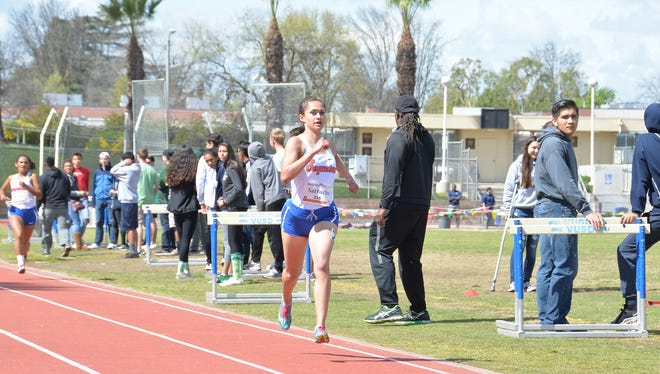 COS track and field athlete Elizabeth Sartuche, a Tulare Union High grad, helped the Giants' women's team capture a conference championship.
