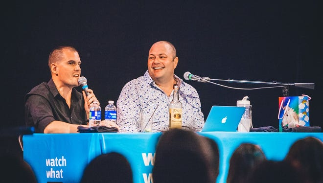 """""""Watch What Crappens"""" hosts Ben Mandelker and Ronnie Karam photographed during a live podcast recording."""