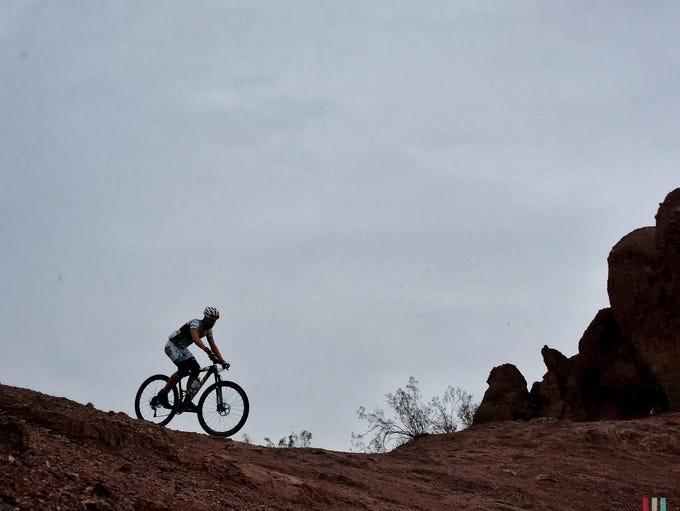 Evan Pardi rides his bike in the rain on Sept. 29,