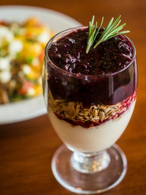Chef Jonathan Davis at the Starving Artist The yogurt and granola parfait garnished with rosemary at The Starving Artist Cafe at David Studio on Shelburne Road in South Burlington.