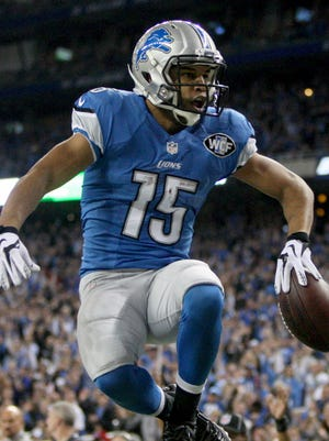 Detroit Lions WR Golden Tate scores a touchdown against the Minnesota Vikings on Dec. 14, 2014 at Ford Field in Detroit.