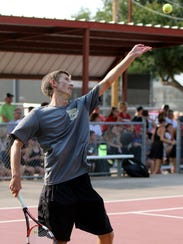 Rider's Chris Selsor serves in a match against Wichita