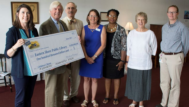 The Franklin P. and Arthur W. Perdue Foundation has committed $100,000 in funding to support the new Eastern Shore Public Library in Parksley, Virginia. From left are: Kim Nechay, executive director of the Perdue Foundation; Fitz Godwin, president of the Eastern Shore Public Library Foundation; John Edmonds, chairman of the Library Foundation; Cara Burton, library director; Bel Holden, Perdue human resources manager in Accomac; Kitty Hall, chair of the library board of trustees; and Tamra Langford, Perdue business unit leader in Accomac.