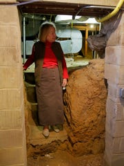 Elaine Lent walks through the basement at The Old First
